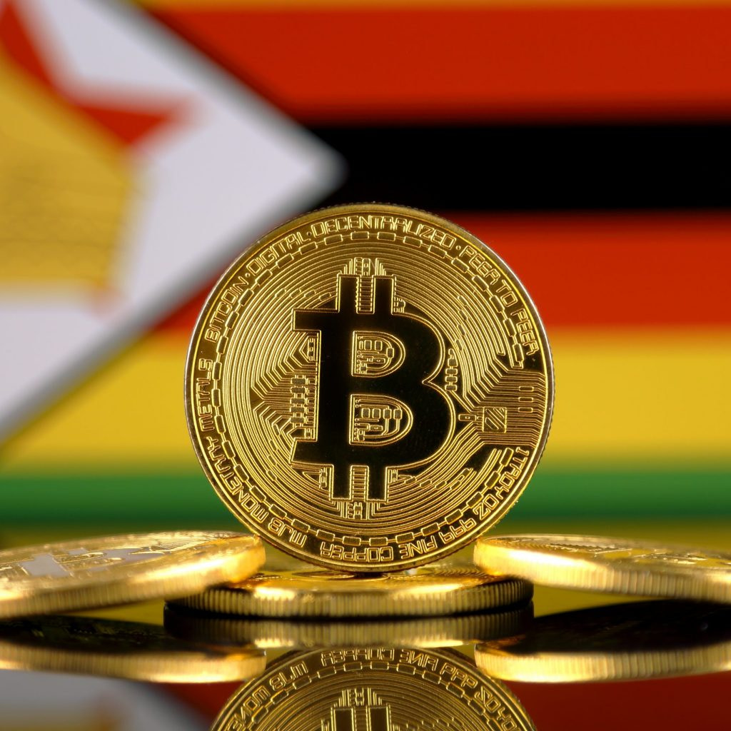 Physical version of Bitcoin (new virtual money) and Africa Flag. Conceptual image for investors in cryptocurrency and Blockchain Technology in Africa.