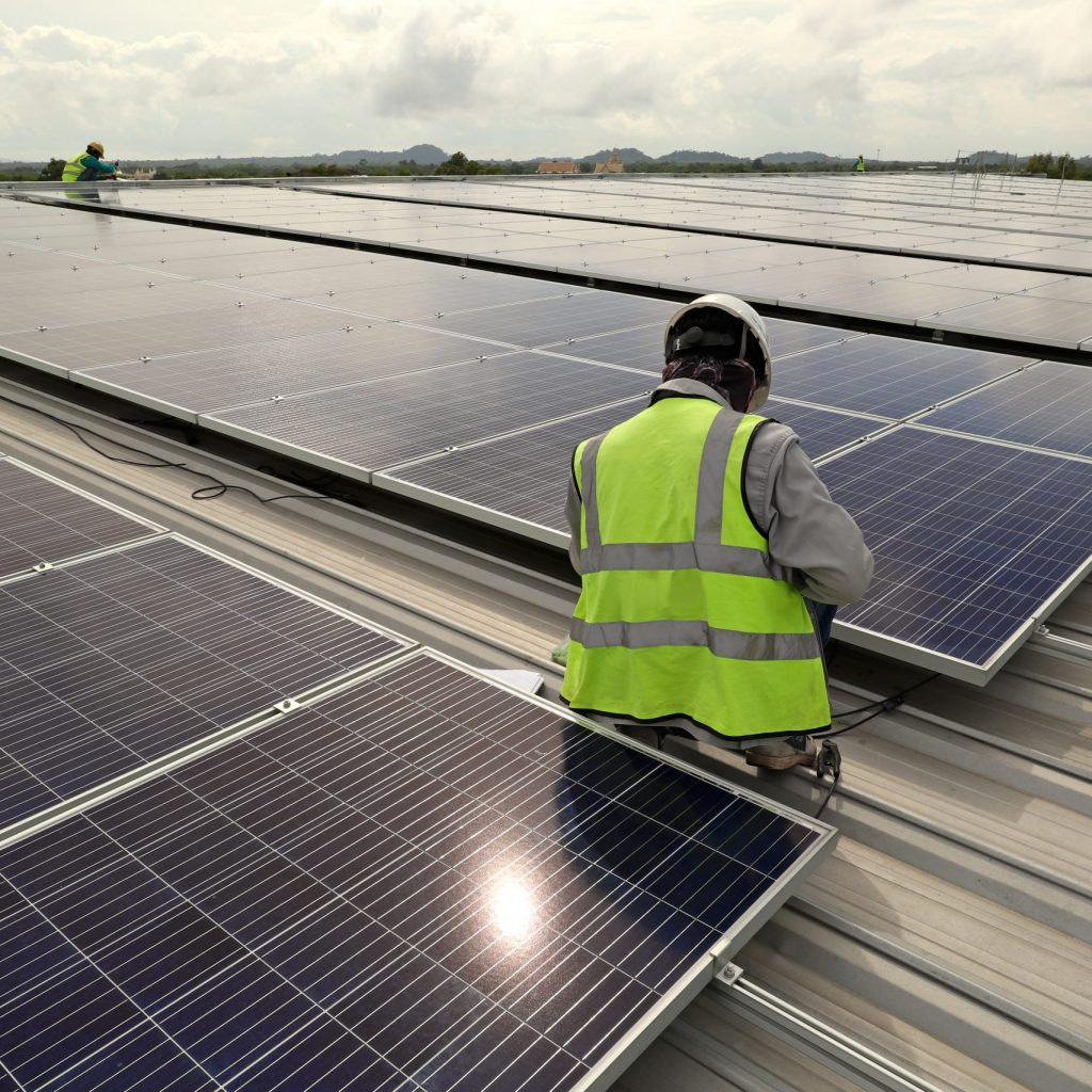 Technician Connecting Cable Solar Rooftop